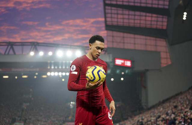 Liverpool's Trent Alexander-Arnold holds the ball during the English Premier League soccer match between Liverpool and Manchester United at Anfield Stadium in Liverpool, Sunday, Jan. 19, 2020.(AP Photo/Jon Super)