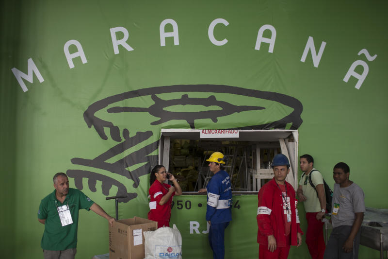 Workers take a break during final preparations at the Maracana stadium ahead of the soccer Confederations Cup in Rio de Janeiro, Brazil, Friday, June 14, 2013. (AP Photo/Felipe Dana)
