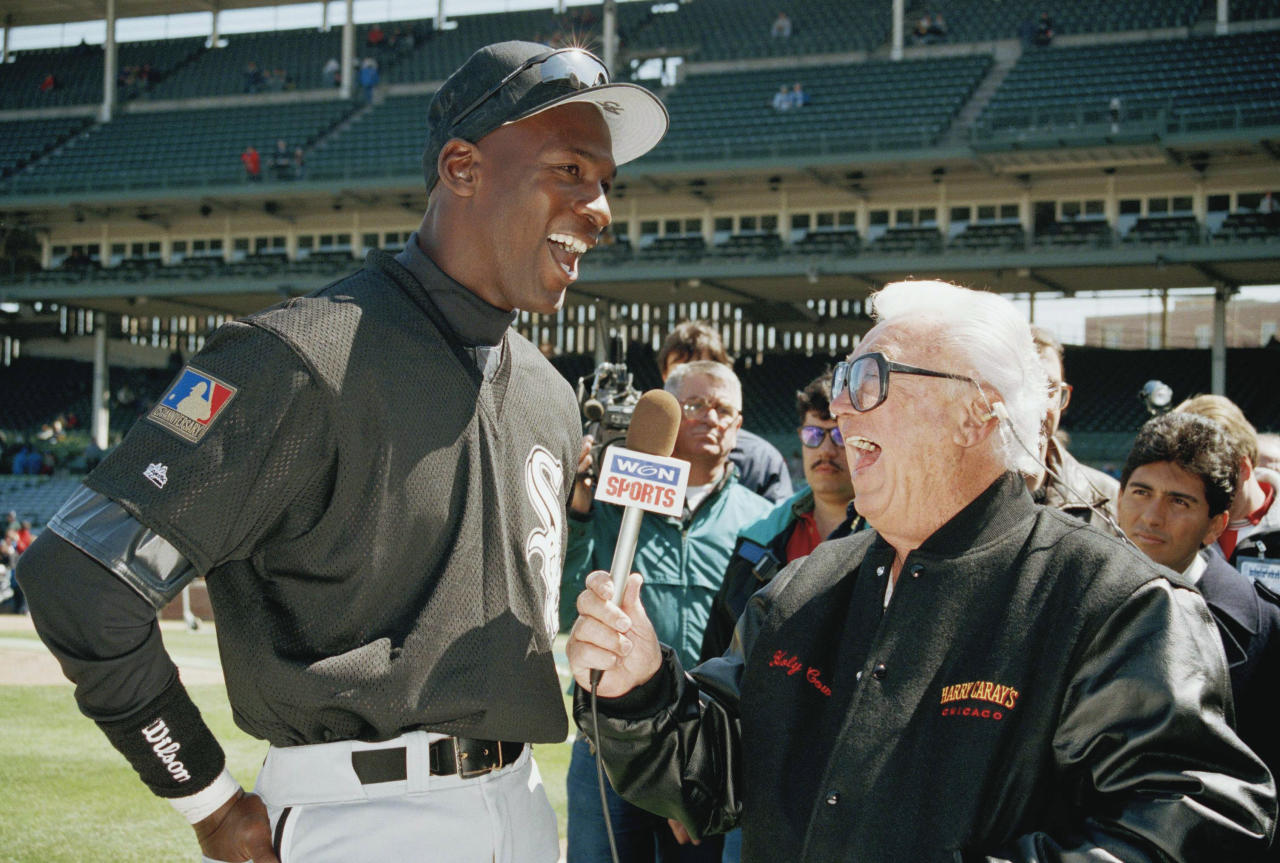 Harry Caray interviews Chicago White Sox' Michael Jordan before the start of the 10th annual cross-town classic between the Sox and the Chicago Cubs at Wrigley Field in Chicago, Thursday, April 7, 1994. After playing in the game on Thursday, Jordan will make his minor league debut on Friday for the Birmingham Barons. (AP Photo/Mark Elias)