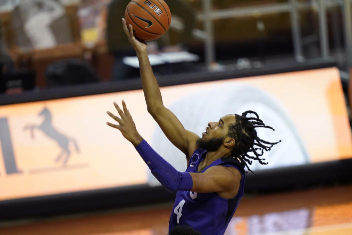 TCU guard PJ Fuller (4) drives to the basket against Texas during the first half of an NCAA college basketball game, Saturday, Feb. 13, 2021, in Austin, Texas. (AP Photo/Eric Gay)
