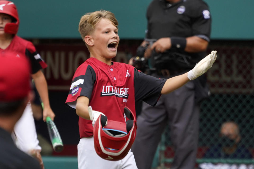 Hamilton, Ohio's Krew Brown celebrates as he returns to the dugout after scoring during the second inning of a baseball game against Sioux Falls, S.D. at the Little League World Series in South Williamsport, Pa., Saturday, Aug. 28, 2021. (AP Photo/Gene J. Puskar)