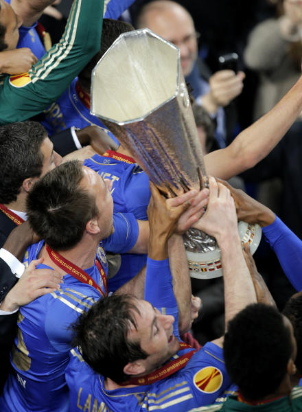 Chelsea players John Terry, left, and Frank Lampard celebrate with the trophy after winning the Europa League final soccer match between Benfica and Chelsea at ArenA stadium in Amsterdam, Netherlands, Wednesday May 15, 2013. Chelsea won 2-1. (AP Photo/Peter Dejong)