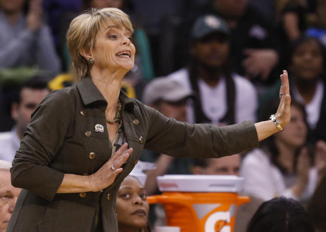 Baylor head coach Kim Mulkey gestures in the first half of an NCAA college basketball game against Kansas in the quarterfinals of the Big 12 Conference women's college tournament in Oklahoma City, Saturday, March 8, 2014. Baylor won 81-47. (AP Photo/Sue Ogrocki)