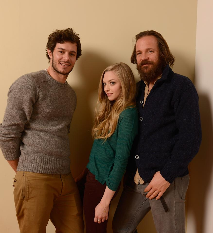 PARK CITY, UT - JANUARY 22:  (L-R) Actors Adam Brody, Amanda Seyfried and Peter Sarsgaard pose for a portrait during the 2013 Sundance Film Festival at the Getty Images Portrait Studio at Village at the Lift on January 22, 2013 in Park City, Utah.  (Photo by Larry Busacca/Getty Images)