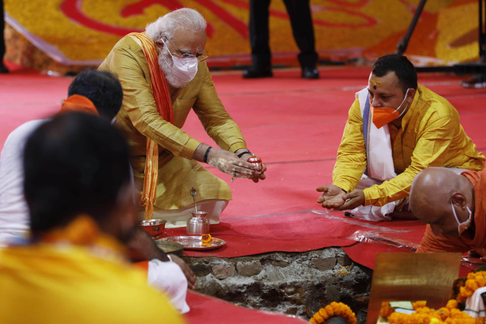 Indian Prime Minister Narendra Modi performs the groundbreaking ceremony of a temple dedicated to the Hindu god Ram, in Ayodhya, India, Wednesday, Aug. 5, 2020. The coronavirus is restricting a large crowd, but Hindus were joyful before Prime Minister Narendra Modi breaks ground Wednesday on a long-awaited temple of their most revered god Ram at the site of a demolished 16th century mosque in northern India. (AP Photo/Rajesh Kumar Singh)