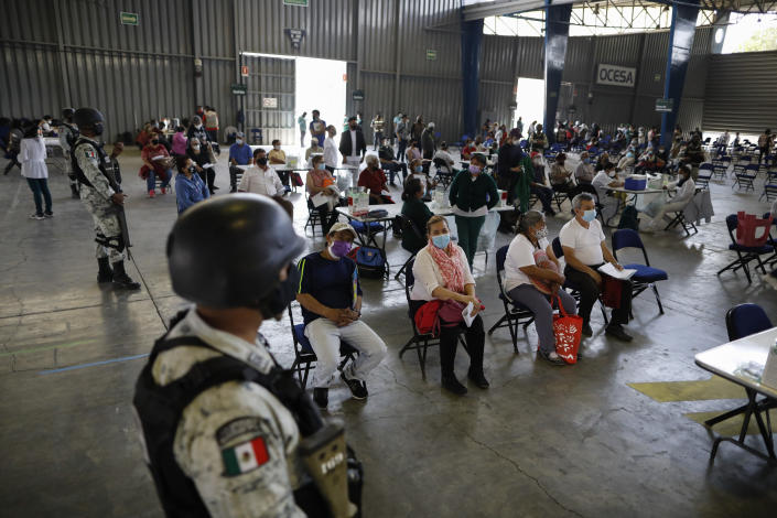 Residents over age 60 wait to be vaccinated with the Russian COVID-19 vaccine Sputnik V at the Palacio de los Deportes, in the Iztacalco borough of Mexico City, Wednesday, Feb. 24, 2021. (AP Photo/Rebecca Blackwell)