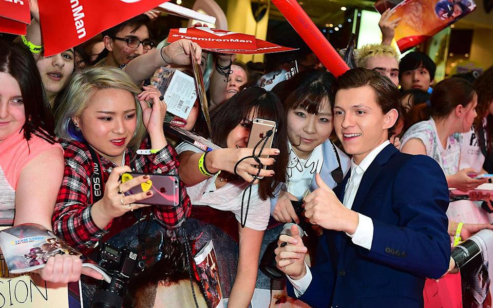 Tom Holland, the new Spider-Man, took time to meet his adoring fans. Credit: PA