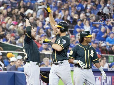May 19, 2018; Toronto, Ontario, CAN; Oakland Athletics shortstop Chad Pinder (18) celebrates hitting a grand slam home run with Oakland Athletics second baseman Jed Lowrie (8) during the eighth inning against the Toronto Blue Jays at Rogers Centre. Mandatory Credit: Nick Turchiaro-USA TODAY Sports