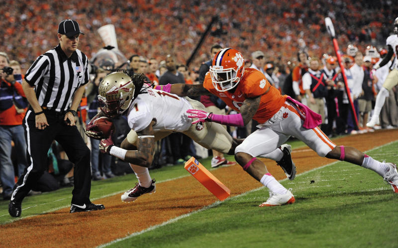 Florida State wide receiver Kelvin Benjamin (1) makes the catch for a touchdown against Clemson cornerback Darius Robinson (8) during the first half of an NCAA college football game, Saturday, Oct. 19, 2013, in Clemson, S.C. (AP Photo/Richard Shiro)