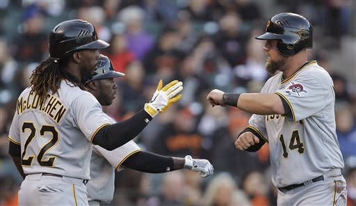 Pittsburgh Pirates' Casey McGehee, right, is congratulated after scoring against the San Francisco Giants by teammate Andrew McCutchen (22) during the first inning of a baseball game Saturday, April 14, 2012, in San Francisco. (AP Photo/Ben Margot)