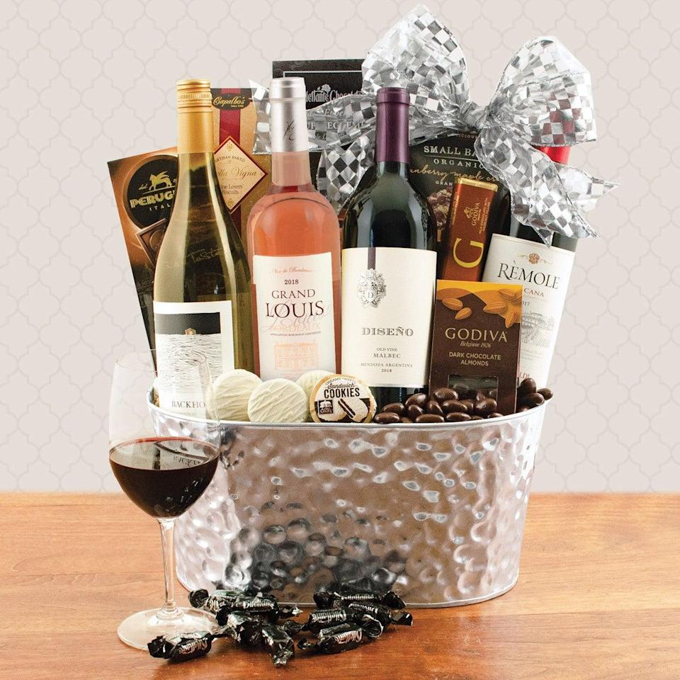 """<h2>Wine Lover's Collection Gift Basket</h2><br>For the chocolate lover, gift them a tasty wine basket brimming with Godiva chocolate, white wine, and truffle cremes. Mmm. <br><br><strong><em><a href=""""https://fave.co/2IJ693y"""" rel=""""nofollow noopener"""" target=""""_blank"""" data-ylk=""""slk:Shop Wine Basket"""" class=""""link rapid-noclick-resp"""">Shop Wine Basket</a></em></strong> <br><br><strong>Wine Basket</strong> Wine Lover's Collection Gift Basket, $, available at <a href=""""https://go.skimresources.com/?id=30283X879131&url=https%3A%2F%2Ffave.co%2F38OL6b6"""" rel=""""nofollow noopener"""" target=""""_blank"""" data-ylk=""""slk:Wine Basket"""" class=""""link rapid-noclick-resp"""">Wine Basket</a>"""