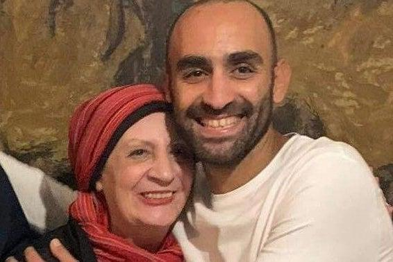 <p>Karim Ennarah with his mother after release</p> (Jessica Kelly)