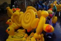 Demonstrators use inflatable rubber ducks as shields to protect themselves from water cannons during an anti-government protest in Bangkok