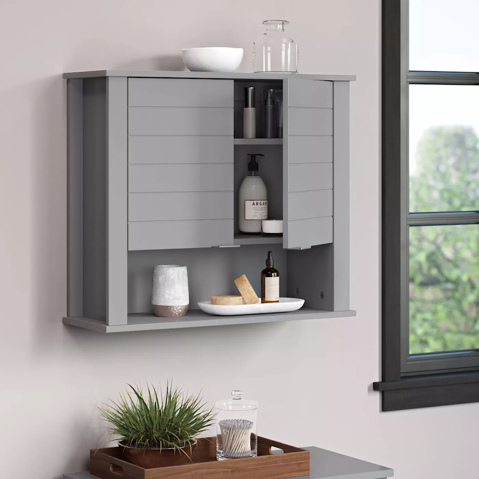 "<h3><a href=""https://goto.target.com/Nnkvq"" rel=""nofollow noopener"" target=""_blank"" data-ylk=""slk:Madison Collection Two Door Wall Cabinet"" class=""link rapid-noclick-resp"">Madison Collection Two Door Wall Cabinet</a></h3><br><strong>When your bathroom can't contain your beauty routine</strong>: This wall-mountable bathroom cabinet is the answer to containing your overload of personal products — from hair to skincare, beauty essentials, and more.<br><br><strong>Madison Collection</strong> Two Door Wall Cabinet, $, available at <a href=""https://go.skimresources.com/?id=30283X879131&url=https%3A%2F%2Fgoto.target.com%2FNnkvq"" rel=""nofollow noopener"" target=""_blank"" data-ylk=""slk:Target"" class=""link rapid-noclick-resp"">Target</a>"