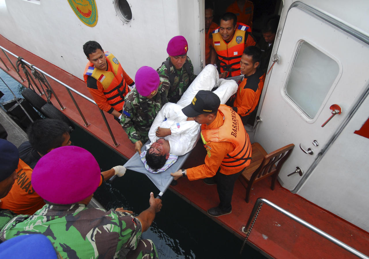 A survivor from a boat reportedly carrying about 150 asylum seekers that sank off Java island, is stretchered by Indonesian rescuers upon arrival at a port in Merak, Banten province, Indonesia, Friday, Aug. 31, 2012. The wooden fishing boat sank as it headed for a remote Australian island. More than 50 people had been rescued by Friday morning, and one body had been recovered, Australian and Indonesian officials said. (AP Photo)