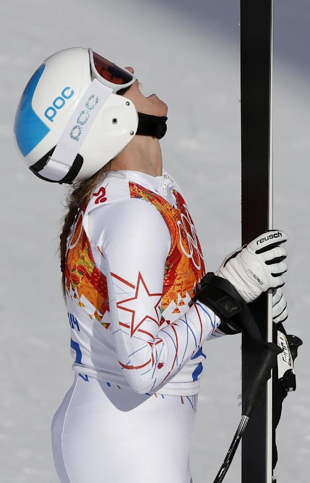 United States' Julia Mancuso rests after finishing the downhill portion of the women's supercombined at the Sochi 2014 Winter Olympics, Monday, Feb. 10, 2014, in Krasnaya Polyana, Russia. (AP Photo/Christophe Ena)