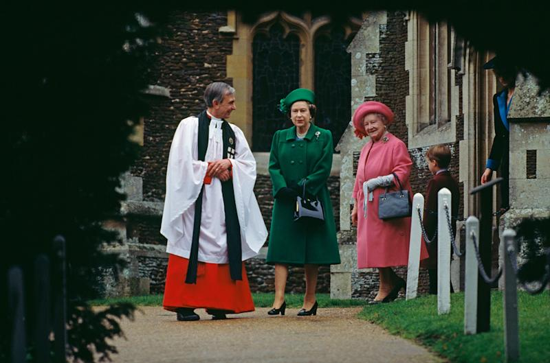 Queen Elizabeth II, the Queen Mother, and Prince William walking with the vicar of St. Mary Magdalene Church near Sandringham House on Christmas Day, 1988.