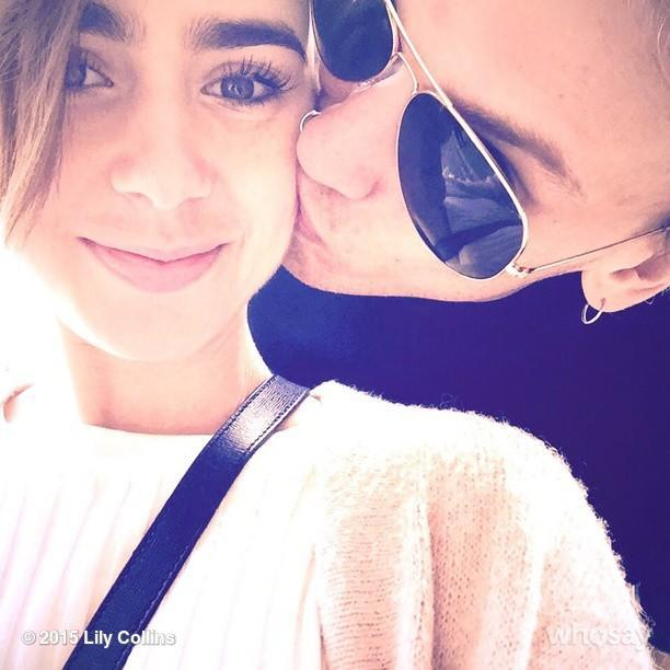 "Looks like Lily Collins' reported romance with <em>Captain America</em> star Chris Evans didn't last very long. The 26-year-old actress confirmed it's back on between her and British actor Jamie Campbell Bower on Wednesday, by sharing two super-sweet snapshots of the two of them flaunting their PDA on Instagram. ""Happy is what happy does. 50 shades of blush #cloud9ispinkright?...,"" Lily wrote alongside a pic of Jamie kissing her cheek. <strong>PHOTOS: The Most On-Again, Off-Again Couples in Hollywood</strong> An hour later, the <em>Mirror Mirror</em> star shared a pic of them smooching, gushing, ""Life works in mysterious ways but when you find your inner glow is back and shining brighter, you know it's right..."" Lily and Jamie met on the set of their 2013 film <em>The Mortal Instruments: City of Bones</em>, and started dating in 2012. They split in August 2013. Since their breakup, she was rumored to have dated Zac Efron, and most recently, the 33-year-old <em>Avengers: Age of Ultron</em> star. <strong>PHOTOS: Lily Collins' Never-Ending Crop Top Style</strong> ET caught up with Lily's reported ex, Chris, at the <em>Avengers: Age of Ultron</em> premiere last month, where he was adorably coy about all the dating rumors surrounding him and Lily! Watch below:"