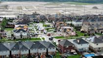 <p>Tornado hits Barrie, Ontario. Residential homes were damaged, cars flipped, and several were left injured after the powerful storm on July 15, 2021. (Edward Loveless/Twitter)</p>