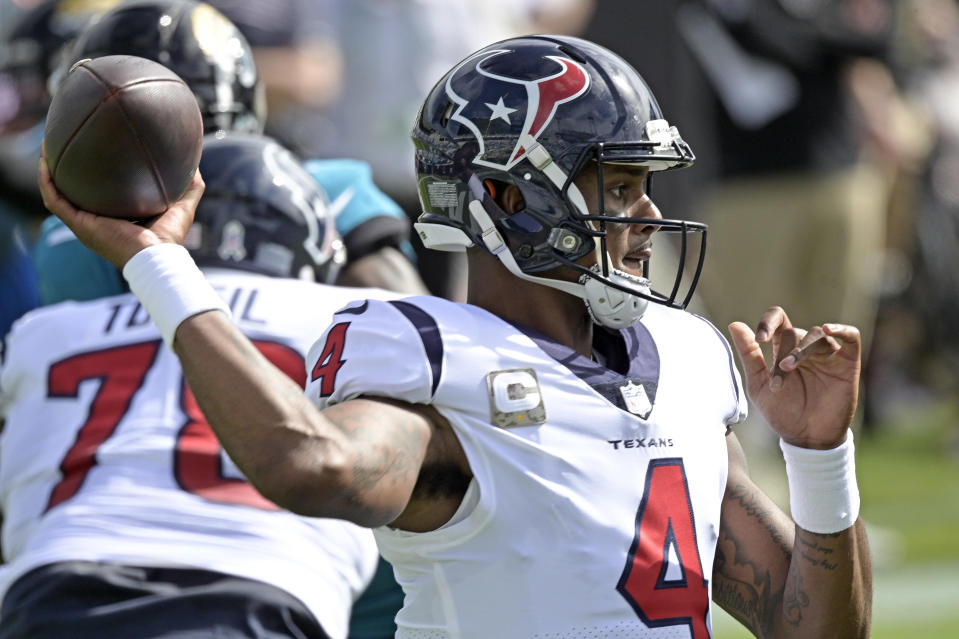 Houston Texans quarterback Deshaun Watson looks for a receiver during the first half of an NFL football game against the Jacksonville Jaguars, Sunday, Nov. 8, 2020, in Jacksonville, Fla. (AP Photo/Phelan M. Ebenhack)