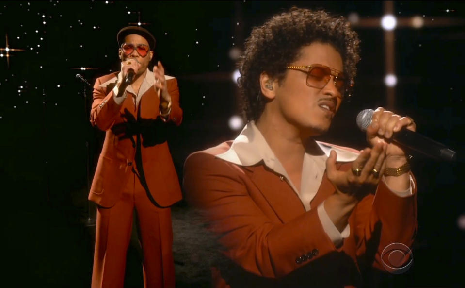 """In this video grab provided by CBS and the Recording Academy, Anderson .Paak, left, and Bruno Mars perform """"Leave The Door Open"""" at the 63rd annual Grammy Awards at the Los Angeles Convention Center on Sunday, March 14, 2021. (CBS/Recording Academy via AP)"""