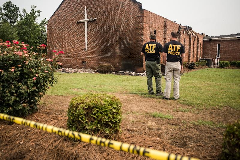 Investigators with the Bureau of Alcohol, Tobacco and Firearms examine the burned ruins of the Mt. Zion AME Church in Greeleyville, South Carolina, on July 1, 2015 (AFP Photo/Sean Rayford)
