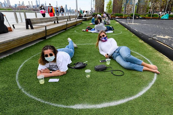 """<span class=""""caption"""">Face masks and social distancing have become the norm in New York City.</span> <span class=""""attribution""""><a class=""""link rapid-noclick-resp"""" href=""""https://www.gettyimages.com/detail/news-photo/people-practice-social-distancing-in-white-circles-in-news-photo/1225475566"""" rel=""""nofollow noopener"""" target=""""_blank"""" data-ylk=""""slk:Noam Galai/Getty Images"""">Noam Galai/Getty Images</a></span>"""