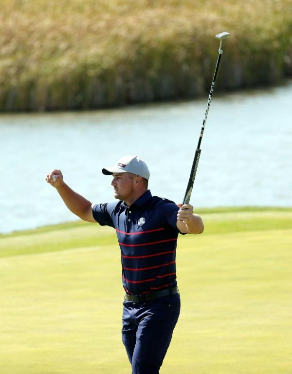 Bryson DeChambeau of the United States enjoys a fist-pumping success during day one of the Ryder Cup (AFP/Stacy Revere)