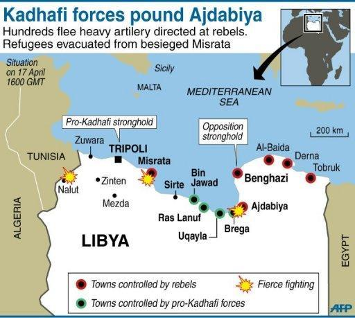 Libyan regime forces pounded rebels with heavy artillery west of Ajdabiya on Sunday, forcing hundreds of residents and some fighters to flee the key crossroads town, as a refugee rescue operation in Misrata was under way
