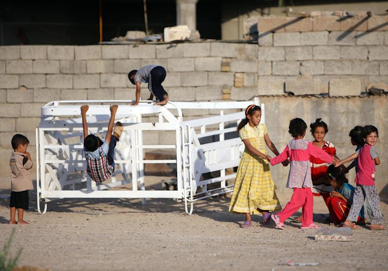 Displaced Iraqi children who fled Wadi Osaj village take shelter in a village near the Diyala province town of Khaniqin on August 25, 2014