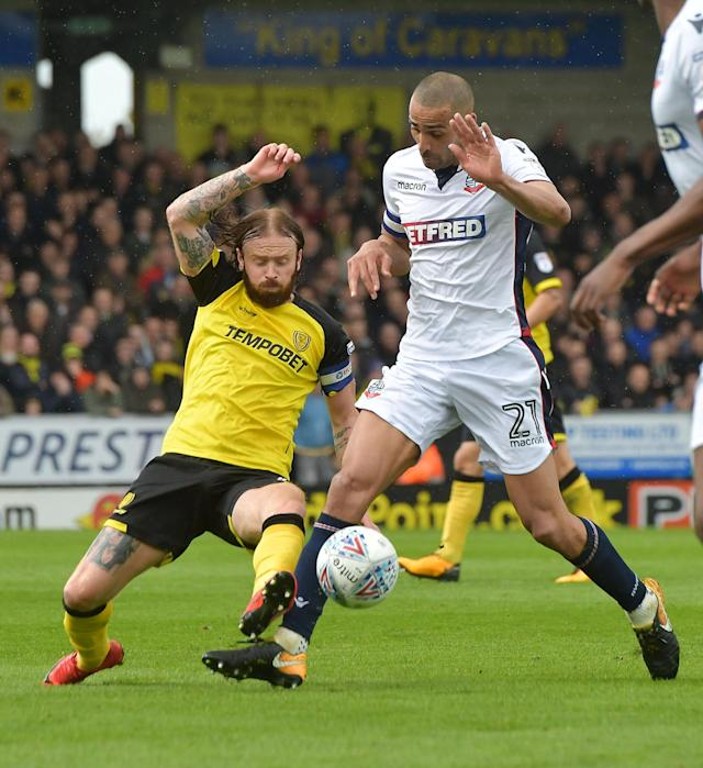 "Soccer Football - Championship - Burton Albion vs Bolton Wanderers - Pirelli Stadium, Burton, Britain - April 28, 2018 Burton AlbionÕs John Brayford in action with Bolton Wanderers' Darren Pratley Action Images/Paul Burrows EDITORIAL USE ONLY. No use with unauthorized audio, video, data, fixture lists, club/league logos or ""live"" services. Online in-match use limited to 75 images, no video emulation. No use in betting, games or single club/league/player publications. Please contact your account representative for further details."