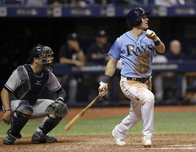 Tampa Bay Rays' Jake Bauers, right, watches his winning home run off New York Yankees relief pitcher Chasen Shreve during the 12th inning of a baseball game Sunday, June 24, 2018, in St. Petersburg, Fla. Yankees catcher Austin Romine, left, looks on. (AP Photo/Chris O'Meara)