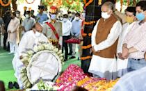 Madhya Pradesh Governor Lalji Tandon passed away on 21 July 2020, aged 85, following a prolonged illness. A member of the Bharatiya Janata Party, Tandon was the leader of the Opposition of the Legislative Assembly of Uttar Pradesh from 2003 till 2007. <br><em><strong>Image credit: </strong></em>LUCKNOW, INDIA - JULY 21: Defence Minister Rajnath Singh pays tribute to Madhya Pradesh Governor Lalji Tandon during his last rites, at Gulala Ghat on July 21, 2020 in Lucknow, India. (Photo by Dheeraj Dhawan/Hindustan Times via Getty Images)