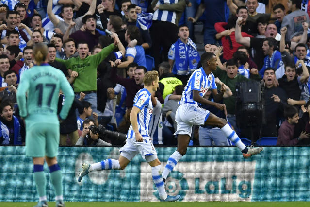 Real Sociedad's Alexander Isak, right, celebrates after scoring his side's second goal during the Spanish La Liga soccer match between Real Sociedad and Barcelona, at Anoeta stadium, in San Sebastian, Spain, Saturday, Dec. 14, 2019. (AP Photo/Alvaro Barrientos)