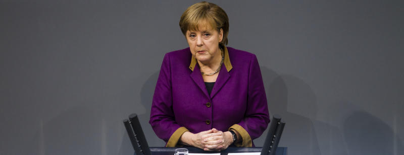 """German Chancellor Angela Merkel delivers her speech prior to the debate and the voting of the German Parliament Bundestag about a new Greek rescue package in Berlin, Germany, Monday, Feb. 27, 2012. Merkel urged German lawmakers to support the new rescue package on, though she conceded that there is no """"100 percent guarantee"""" it will succeed. (AP Photo/Markus Schreiber)"""