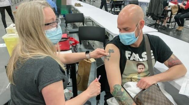 Terrence Wiebe, 40, receives the AstraZeneca COVID-19 vaccine at the Edmonton Expo Centre immunization clinic on April 20, 2021. (AHS - image credit)