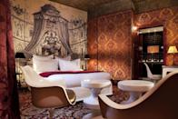 """<p>Behind the gorgeous heritage storefront of one of the oldest bakeries in Paris lies a mysterious boutique hotel. <a href=""""https://www.booking.com/hotel/fr/du-petit-moulin.en-gb.html?aid=1922306&label=paris-hotels"""" rel=""""nofollow noopener"""" target=""""_blank"""" data-ylk=""""slk:Hotel du Petit Moulin"""" class=""""link rapid-noclick-resp"""">Hotel du Petit Moulin</a> contains winding corridors, a balustrade staircase and a collage of boldly-patterned wallpapers. </p><p>Set within two ancient 17th-century buildings, the hotel's 16 unique rooms offer boldly clashing prints and bright, shining 1960s furniture. This playful, theatrical style has been expertly created by fashion designer Christian Lacroix, mixing lush fabrics and vintage wallpapers in a modestly-priced bolthole. </p><p><a class=""""link rapid-noclick-resp"""" href=""""https://www.booking.com/hotel/fr/du-petit-moulin.en-gb.html?aid=1922306&label=paris-hotels"""" rel=""""nofollow noopener"""" target=""""_blank"""" data-ylk=""""slk:CHECK AVAILABILITY"""">CHECK AVAILABILITY</a></p>"""