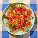 <p>Adjust the heat in this spicy tomato salad by using a milder pepper or just using a little less of a hot one. Sesame oil, tamari and seaweed add lots of umami and nutty flavor to a fresh tomato.</p>