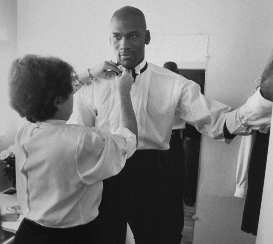 Michael Jordan, modeling a line of formal wear, is fitted for a tuxedo with the help of stylist Jane Collins. (Photo by Steve Kagan/The LIFE Images Collection via Getty Images)