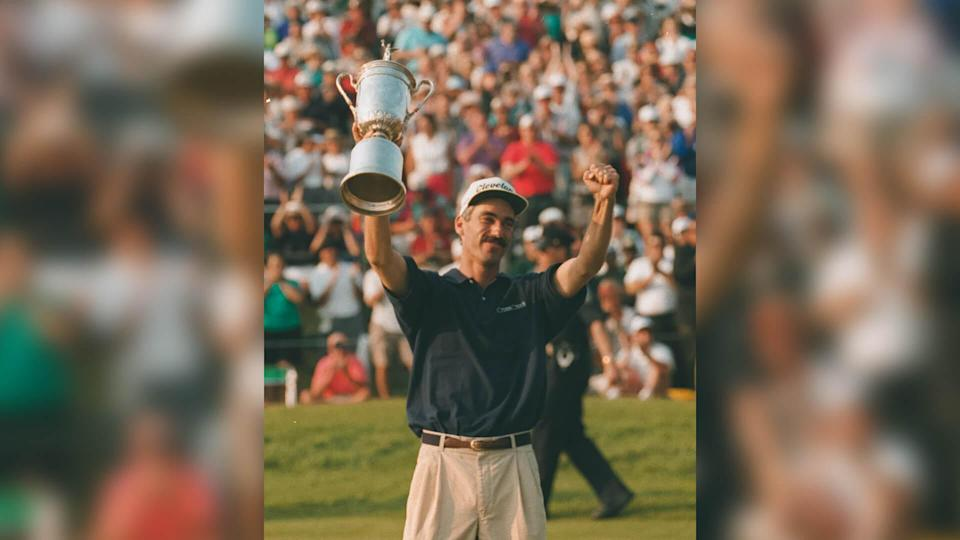 PAVIN Corey Pavin holds the trophy on the 18th green after winning the 95th U.