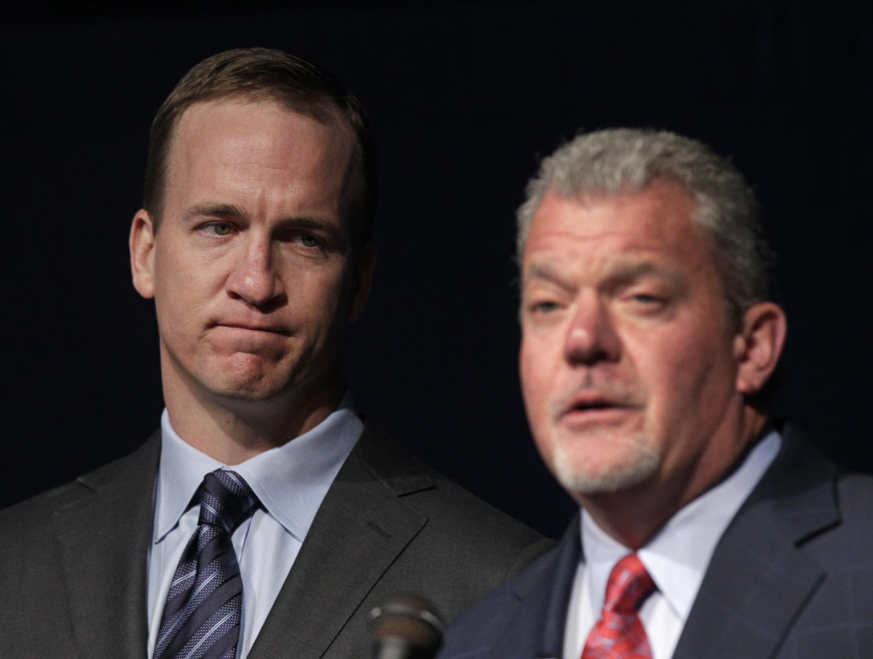 Quarterback Peyton Manning, left, listens as Indianapolis Colts owner Jim Irsay announces that the NFL football team will release quarterback Peyton Manning during a news conference in Indianapolis, Wednesday, March 7, 2012. (AP Photo/Michael Conroy)