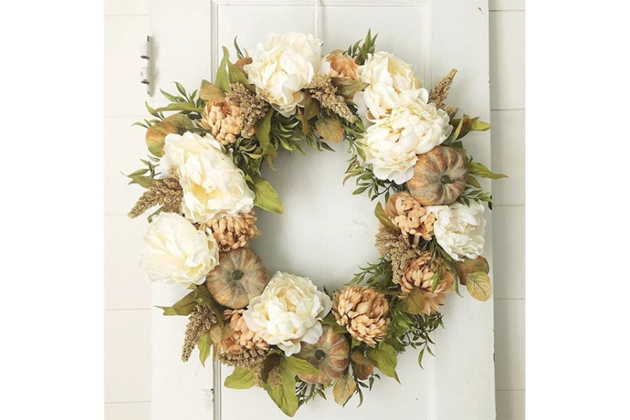 <p>If you're struggling with dry and shriveled fall flowers, look no further than this eye-catching white peony wreath. It will breathe new life into your dried fall décor. Find the wreath at @daisymaebelle on Instagram.</p>
