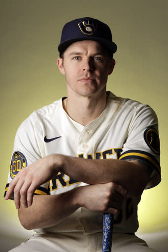 Milwaukee Brewers infielder Brock Holt poses for a portrait during spring training baseball photo day Wednesday, Feb. 19, 2020, in Phoenix. Holt and the Brewers finalized a one-year contract Wednesday, a deal that includes a team option for 2021. (AP Photo/Gregory Bull)