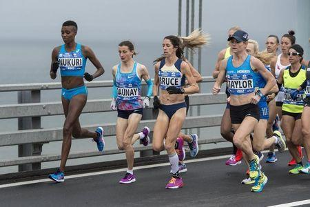 Nov 5, 2017; New York, NY, USA; Diane Nukuri (BDI) and Christelle Daunay (FRA) and Stephanie Bruce (USA) and Kellyn Taylor (USA) compete for second in the New York City marathon as they cross at the Verrazano Bridge. Mandatory Credit: Gregory J. Fisher-USA TODAY Sports