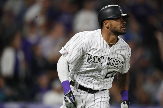 Colorado Rockies' Ian Desmond watches his grand slam off San Diego Padres relief pitcher Robbie Erlin during the fifth inning of a baseball game Saturday, June 15, 2019, in Denver. (AP Photo/David Zalubowski)