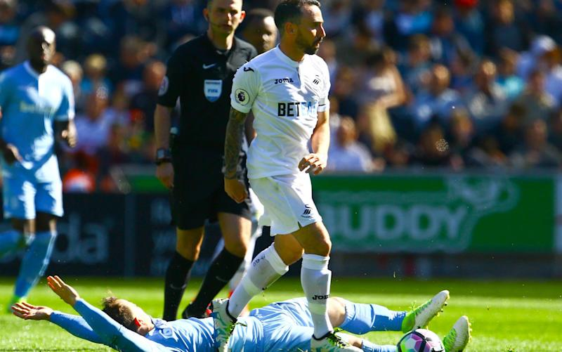 Swansea beat Stoke after Leon Britton handed out a DVD chronicling the darkest days of the club before the Premier League millions started sloshing around south Wales - PA