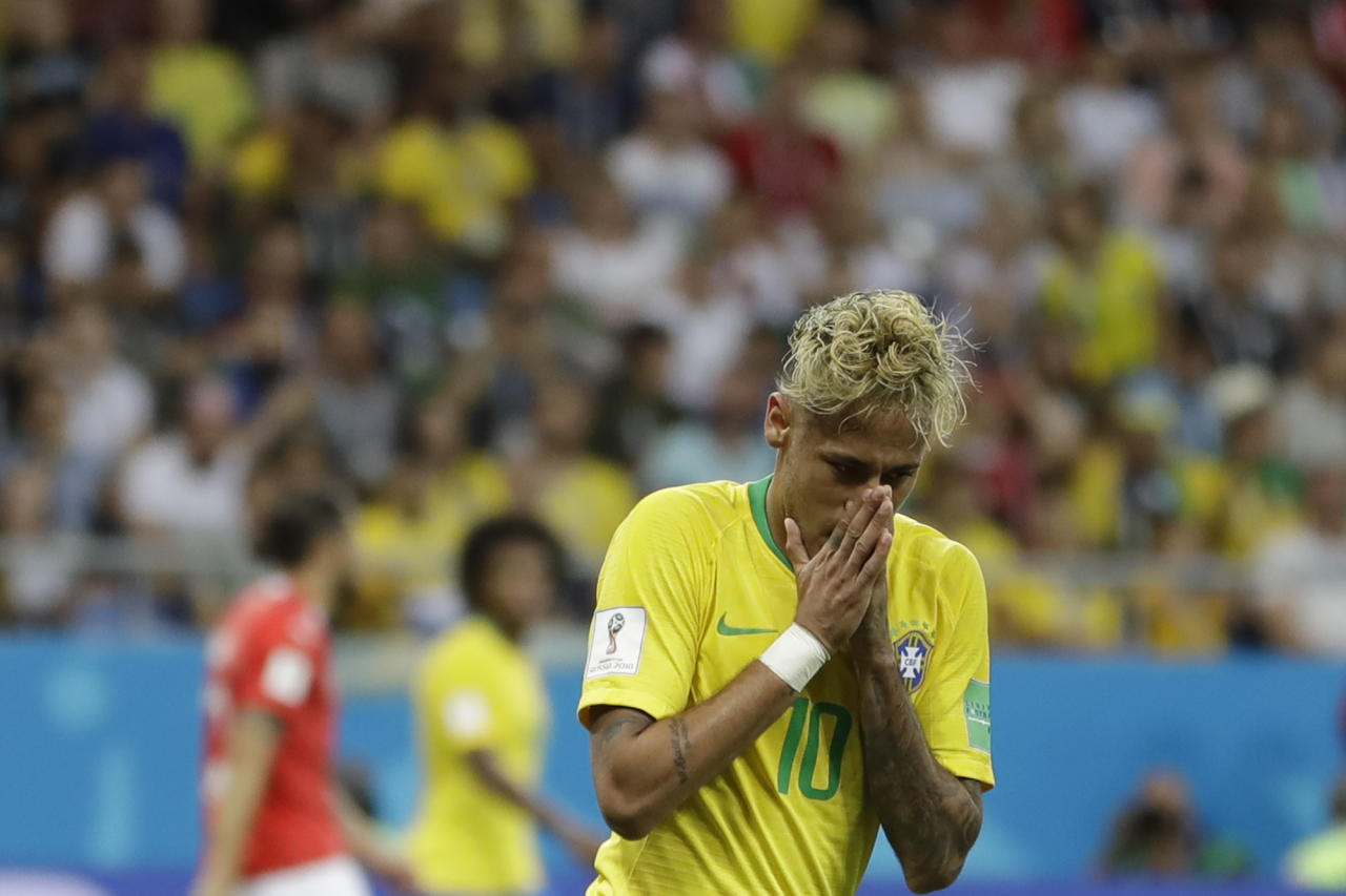 Brazil's Neymar gestures during the group E match against Switzerland at the 2018 soccer World Cup in the Rostov Arena in Rostov-on-Don, Russia, Sunday, June 17, 2018. (AP Photo/Andre Penner)