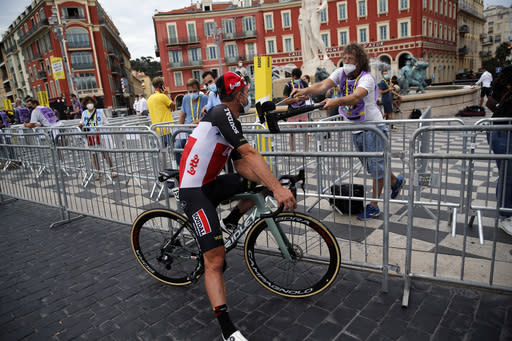 A journalist interviews German John Degenkolb prior to the start of the first stage of the Tour de France cycling race over 156 kilometers (97 miles) with start and finish in Nice, southern France, Saturday, Aug. 29, 2020. (AP Photo/Christophe Ena)