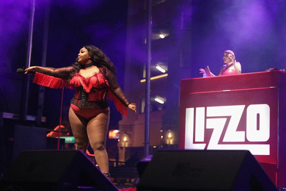 <p>Lizzo gives us Western vibes in a fringe bodysuit during a performance. </p>