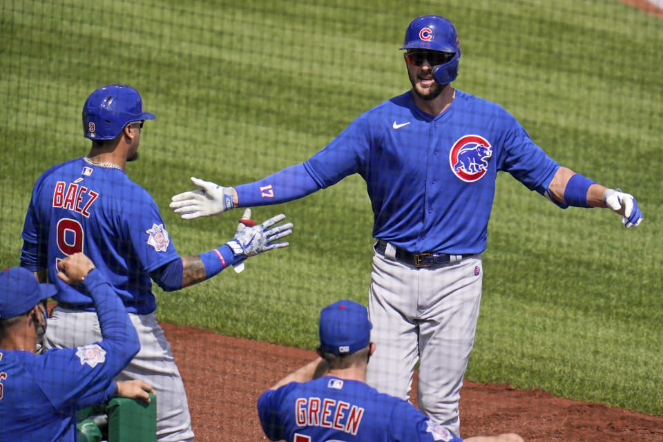 Chicago Cubs' Kris Bryant, right, returns to the dugout after hitting a solo home run off Pittsburgh Pirates starting pitcher Tyler Anderson during the first inning of a baseball game in Pittsburgh, Thursday, April 8, 2021. (AP Photo/Gene J. Puskar)